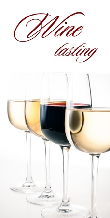 Wine-tasting, a few glasses of red and white wine close-up on a white background, isolated, ready template Stock Photo