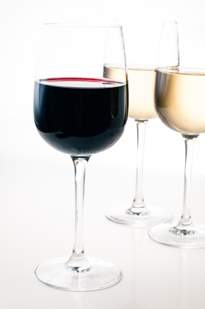 group shot: Wine-tasting, a few glasses of red and white wine close-up on a white background, isolated