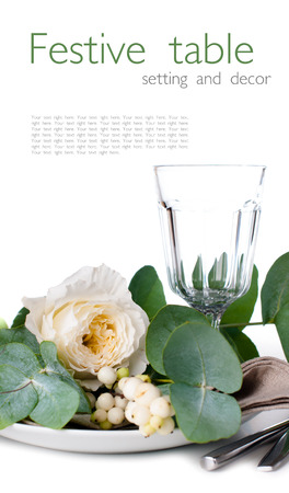Festive table setting with floral decoration, white roses, leaves and berries on a white background, ready template Stock Photo - 22278306