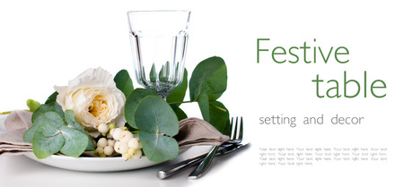 Festive table setting with floral decoration, white roses, leaves and berries on a white background, ready template Stock Photo - 22278308