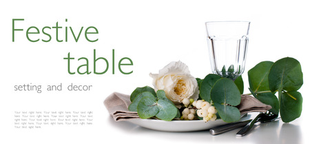 Festive table setting with floral decoration, white roses, leaves and berries on a white background, ready template Stock Photo - 22278310