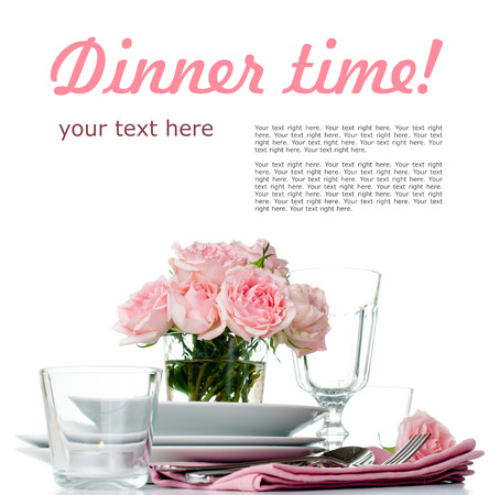 Festive table setting with pink roses, candles and shiny new cutlery on a white background, isolated, ready template photo