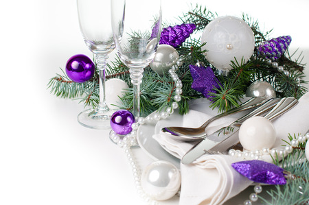 new year eve beads: Festive Christmas table setting, table decoration in purple tones, with fir branches, Christmas balls on a white background, isolated