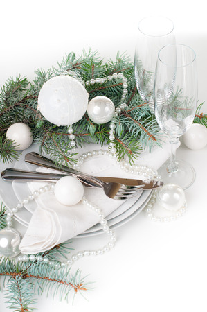 new year eve beads: Festive Christmas table setting, table decoration in white, with fir branches, Christmas balls on a white background, isolated