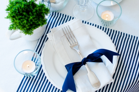 Table setting for breakfast with napkins, cups, plates in navy blue tones on a white background isolated Stok Fotoğraf