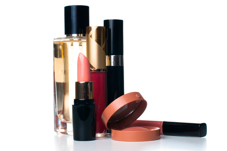 beauty care: makeup set: lipstick, mascara, blush, lipgloss and ferfume, cosmetics on white background isolated