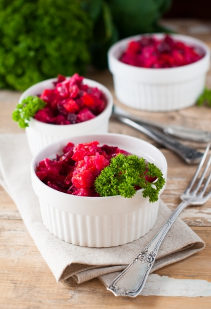 Vegetarian beetroot salad with parsley, useful natural food with vegetables and greens, rural cuisine photo