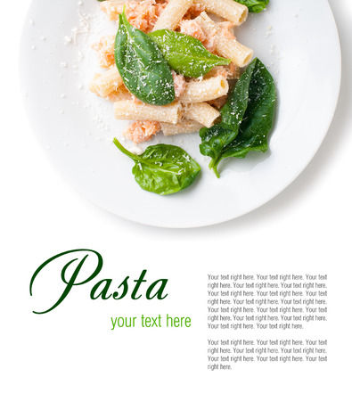 Pasta with salmon and spinach, portion of rigatoni with seafood and parmesan cheese, Italian food, isolated on white background photo