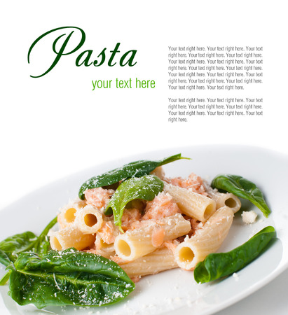 penne: Pasta with salmon and spinach, portion of rigatoni with seafood and parmesan cheese, Italian food, isolated on white background Stock Photo