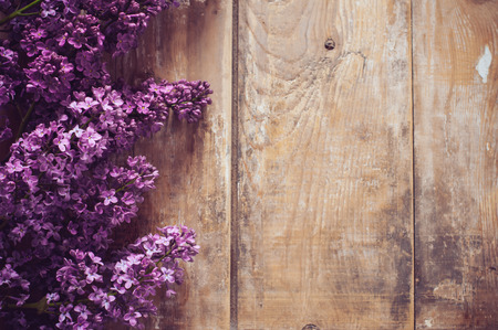 Bouquet of lilac flowers on a wooden board, floral background, rustic style decoration