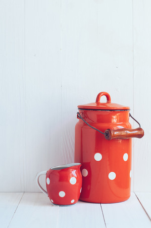 milkman: Set of vintage utensils, milk can and small polka dots milkman, home kitchen decor in country style, painted white background