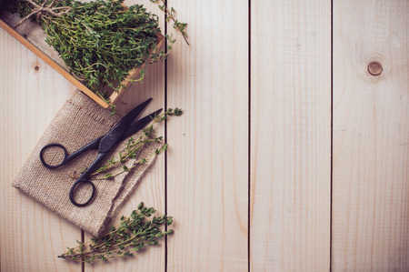 antique scissors: Rustic kitchen still life, dried herbs, old boxes and vintage scissors on a wooden table, home background