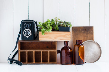 home decor photography. Vintage home decor  old wooden boxes houseplants camera and brown glass bottles Home Decor Old Wooden Boxes Houseplants Camera And
