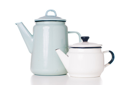 Two different vintage enameled coffee pots, white and blue, isolated on white background photo