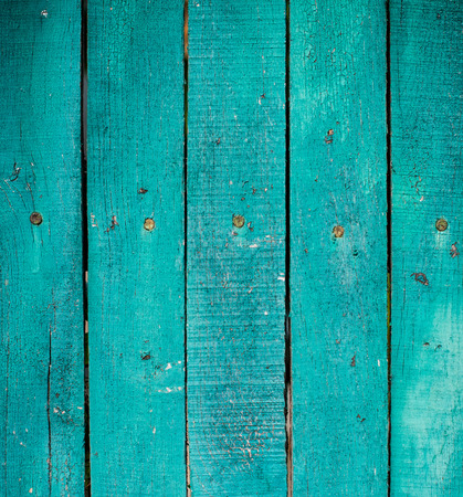 Texture of a green wooden planks, bright barn wall, rustic style