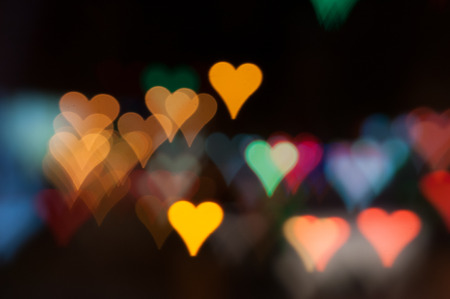 Heart-shaped defocused car lights, city night bokeh, Valentines style lights photo