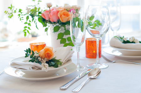 service desk: Elegant festive table setting with colorful flowers, cutlery, candles. Wedding table decoration.