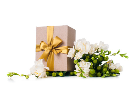 white polka dots: Handmade box with gift and freesia flowers on white background isolated Stock Photo