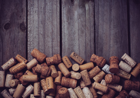 Lots of wine corks on old wooden board