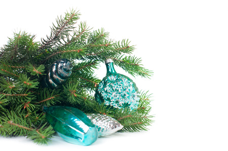 teal: Vintage Christmas decorations and spruce branches on white background isolated