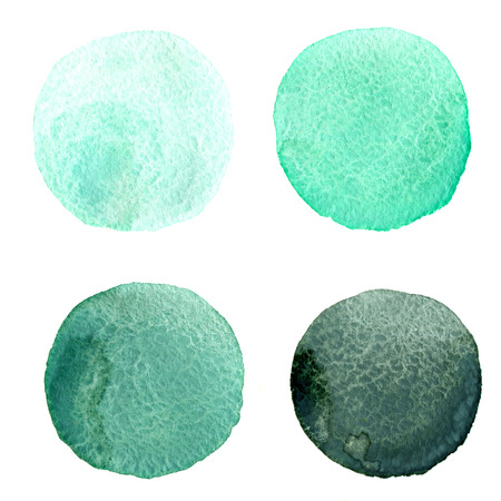 Four round watercolor stains from mint green to dark green on wahite background isolated photo
