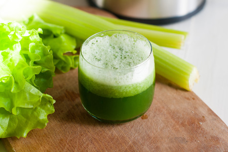 Freshly squeezed juice of fresh cucumber and celery, detox diet, vegan food Imagens