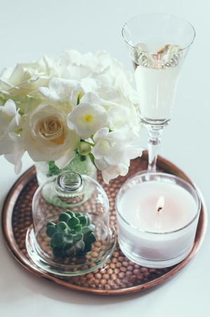 Bouquet Of White Flowers In A Vase Candles And Champagne On Stock