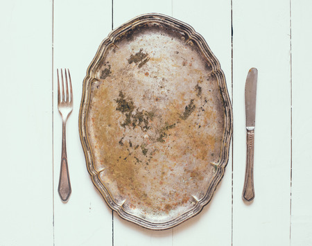 silver tray: silver tray and cutlery on a white board, vintage style Stock Photo