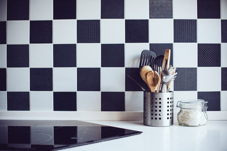 Kitchen utensils on the table by the wall, home interior Stock Photo
