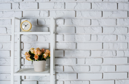 Shelf With Interior Decoration In Front Of A White Brick Wall, Vintage  Decor Photo