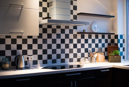 Black and white interior of a modern kitchen, close-up photo