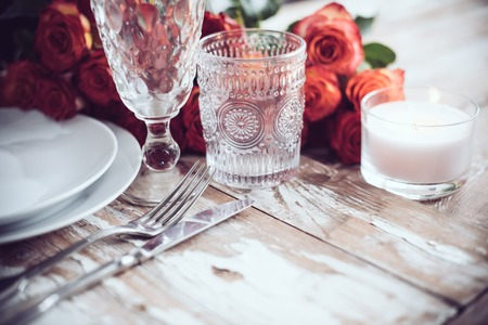 wine colour: Vintage table setting with glasses and cutlery on an old wooden board, wedding table decor