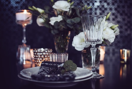 Luxury festive table setting with candles