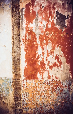 pared rota: Abstract texture of old red paint on the broken wall Foto de archivo