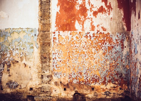 broken wall: Abstract texture of old red paint on the broken wall Stock Photo