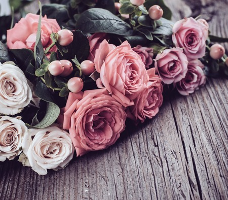 fresh natural pink and beige roses on old vintage wooden board, close-up Stock fotó