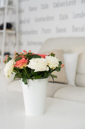 flowers in vase: Simple home interior decoration, vase of flowers on a table in the interior of modern apartment Stock Photo