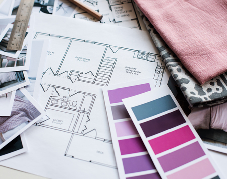 interior designers: Interior designers working table, an architectural plan of the house, a color palette, furniture and fabric samples in grey and pink color. Drawings and plans for house decoration.