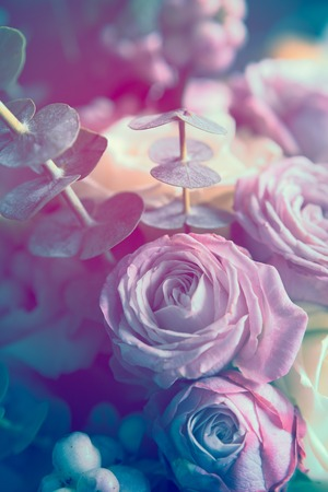 Elegant bouquet of pink and white roses on a dark background, soft focus, close-up. Romantic hipster background. Vintage filter. Zdjęcie Seryjne