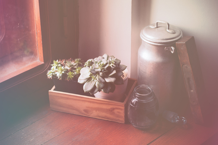 antiques: Vintage still life, antiques on a brown wooden windowsill.