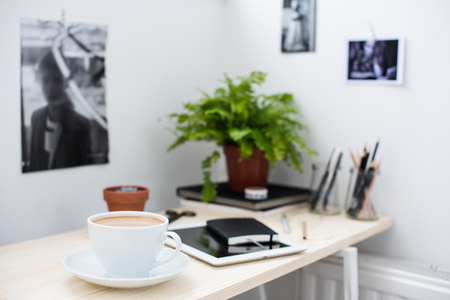 office working table. Cup Of Coffe In Bright And Modern Loft-style Office, Work Desk With Office Working Table B