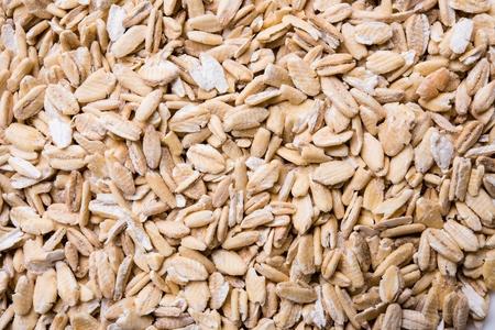 groats: Natural oat groats macro shot. Food texture. Stock Photo