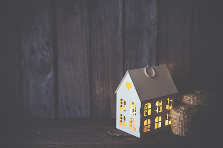 wall decoration: Cozy vintage home decoration: warm interior night light on an old wooden board background. Stock Photo