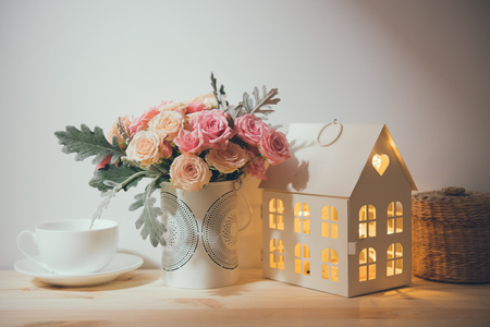 wall decor: Beautiful vintage home decorations: flowers and decorative objects on the shelf by the wall. House decor background. Stock Photo