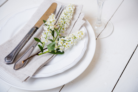 selebration: The snow white wedding table decor with bird cherry blossoms and cutlery, vintage rustic wedding table setting