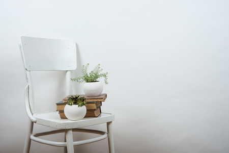 interior wall: White chair and empty wall background, room interior wall art poster mock up