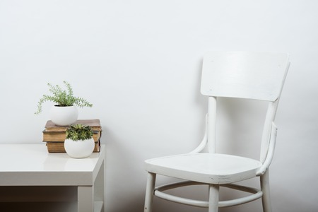White chair and empty wall background, room interior wall art poster mock up Stock fotó - 57907472