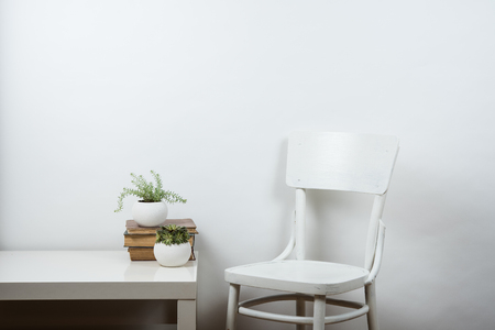 White chair and empty wall background, room interior wall art poster mock up