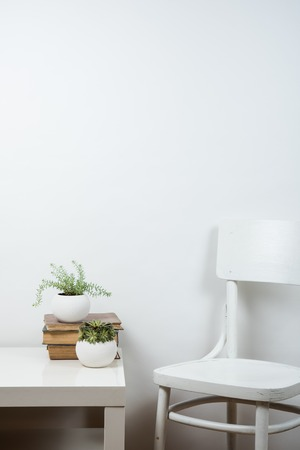 White chair and empty wall background, room interior wall art poster mock up Stock fotó - 57907478