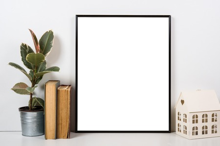 styled interior: Styled tabletop, empty frame, painting art poster interior mock-up isolated closeup